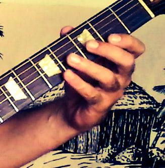 Manjess et sa guitare